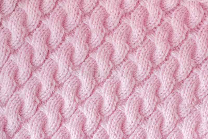 Πλεκτό ύφασμα φιαγμένο από ρόδινο χρώμα νημάτων μαλλιού πρότυπο στοκ φωτογραφία με δικαίωμα ελεύθερης χρήσης