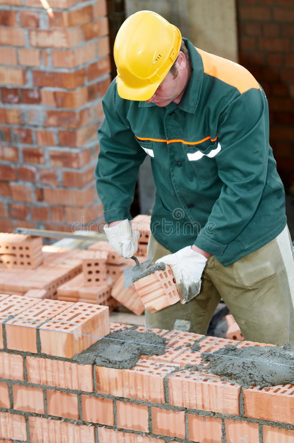 Πλινθοκτίστης εργαζομένων κτιστών κατασκευής στοκ εικόνα με δικαίωμα ελεύθερης χρήσης