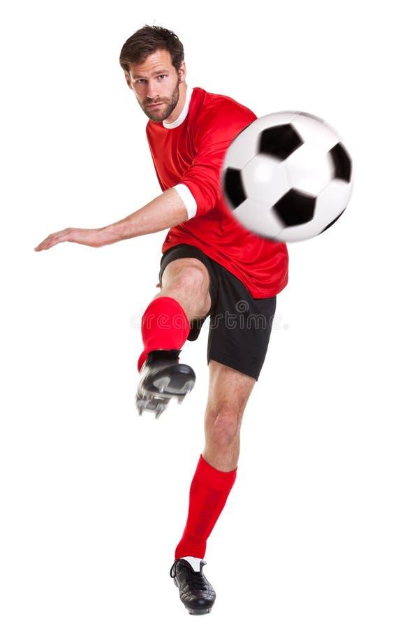 Ποδοσφαιριστής που αποκόβεται στο λευκό στοκ φωτογραφία με δικαίωμα ελεύθερης χρήσης
