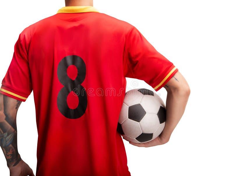 Ποδοσφαιριστής που στέκεται με μια σφαίρα που απομονώνεται στο λευκό στοκ εικόνες με δικαίωμα ελεύθερης χρήσης