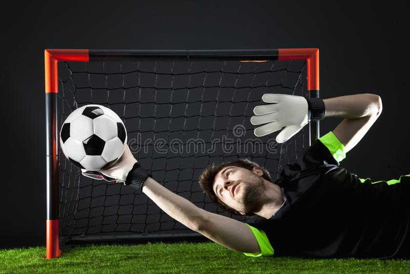 ποδόσφαιρο Αντιστοιχία Fotball Έννοια πρωταθλήματος με τη σφαίρα ποδοσφαίρου στοκ εικόνα με δικαίωμα ελεύθερης χρήσης