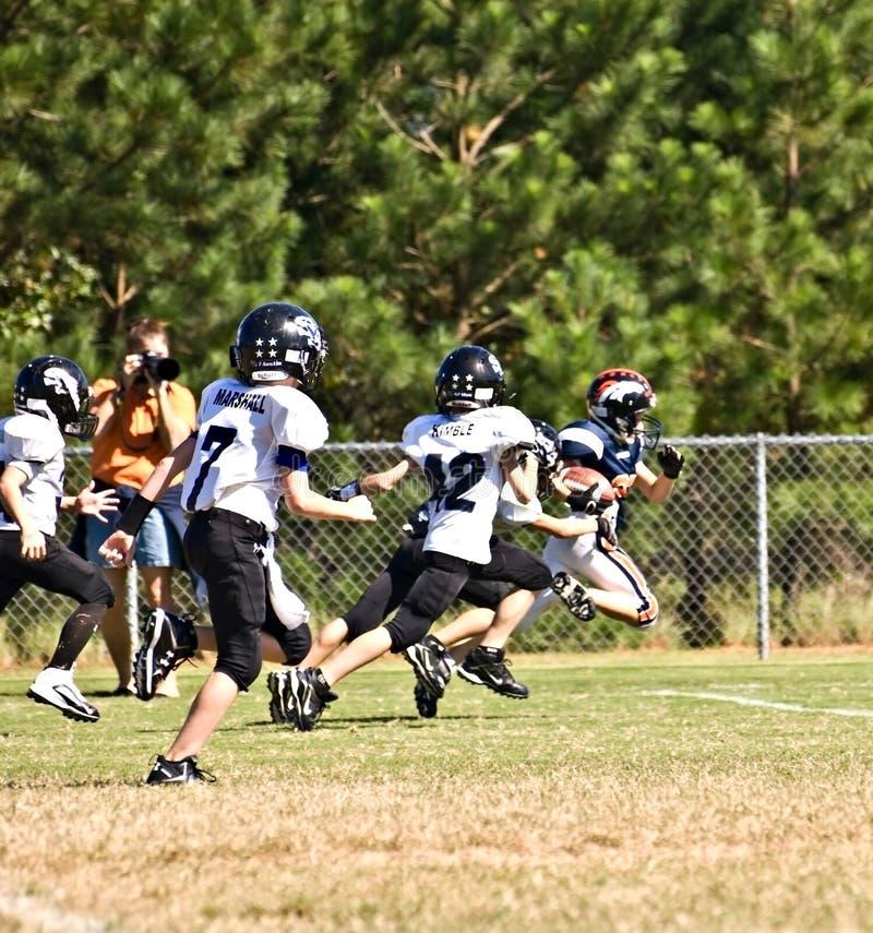 ποδόσφαιρο που κάνει touchdown τ&et στοκ φωτογραφία