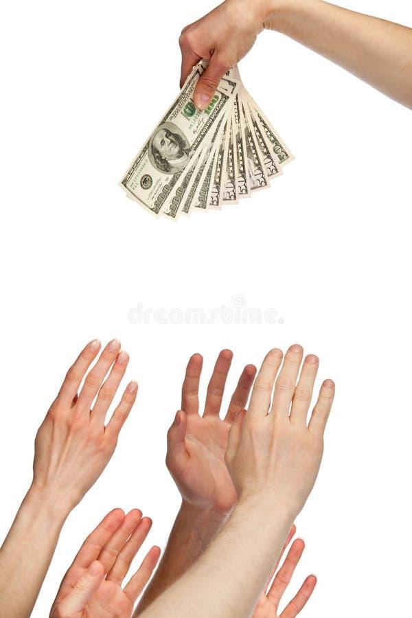 Πολλά χέρια που φτάνουν για τα χρήματα στοκ φωτογραφία