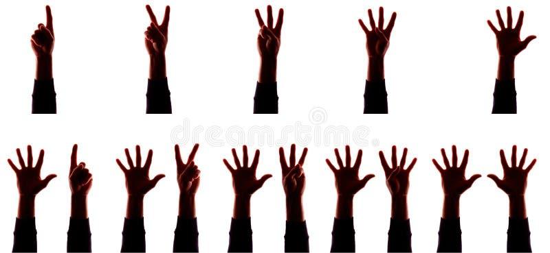 Πολλοί νεαρός άνδρας του χεριού με τα δάχτυλα χώρια, αριθμοί - σκιαγραφήστε, έννοια στοκ εικόνες