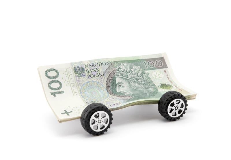 Πολωνικά χρήματα στις ρόδες που απομονώνονται στο λευκό στοκ φωτογραφία με δικαίωμα ελεύθερης χρήσης