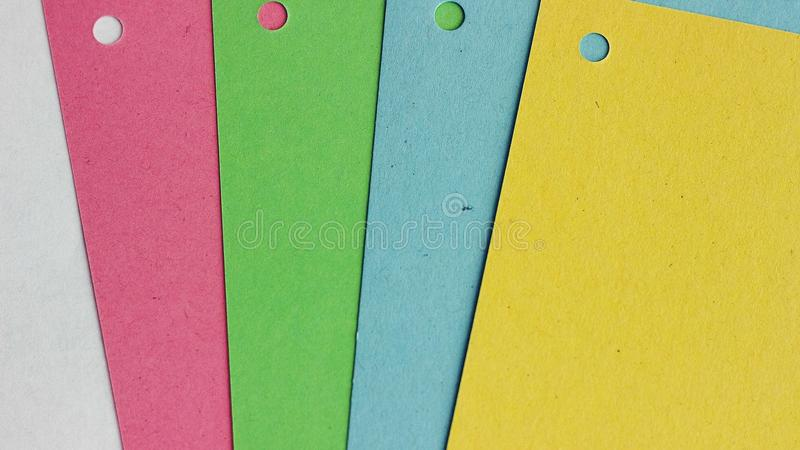 Πολύχρωμο υπόβαθρο εγγράφου Χαρτοκιβώτια των διαφορετικών χρωμάτων στοκ φωτογραφίες