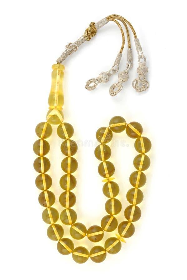 Πολύ καθαρό κίτρινο βαλτικό ηλέκτρινο rosary που απομονώνεται στο λευκό στοκ εικόνες με δικαίωμα ελεύθερης χρήσης