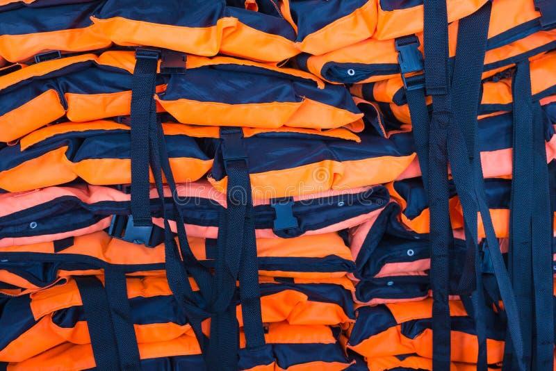 Πολύ πορτοκαλί υπόβαθρο σακακιών ανελκυστήρων στοκ εικόνες