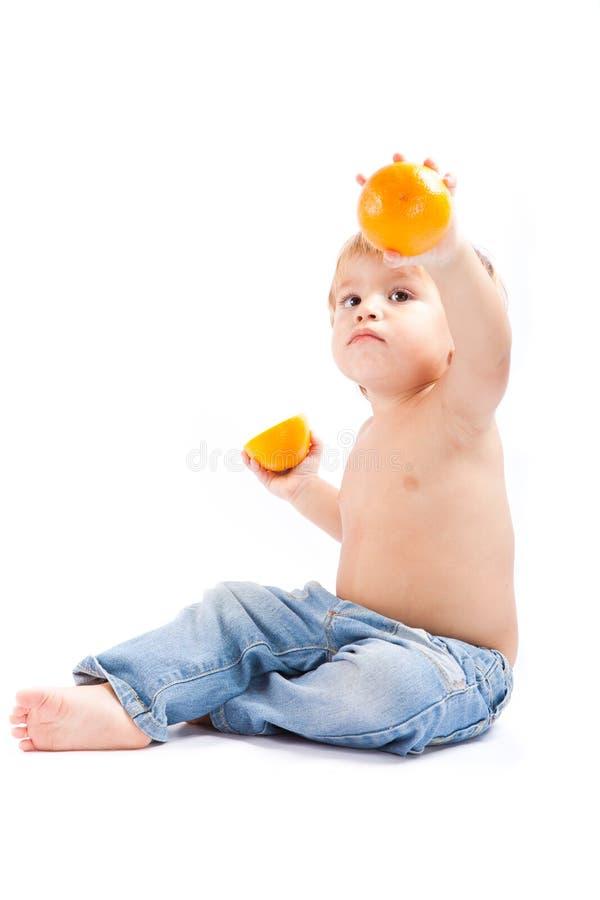 πορτοκάλι αγοριών στοκ φωτογραφία με δικαίωμα ελεύθερης χρήσης