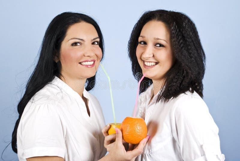 πορτοκαλιά γυναίκα δύο χ&u στοκ εικόνες με δικαίωμα ελεύθερης χρήσης