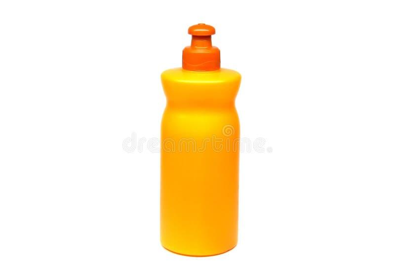 Πορτοκαλί μπουκάλι που χρησιμοποιείται για το σαμπουάν και άλλα κρέμες ή πηκτώματα στοκ εικόνες