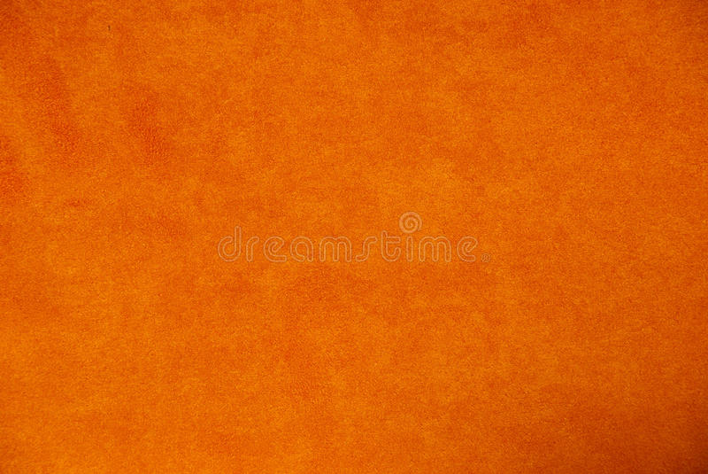 Πορτοκαλί υπόβαθρο σουέτ στοκ εικόνες