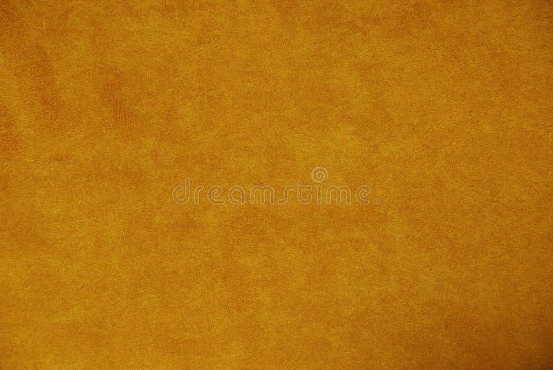 Πορτοκαλί υπόβαθρο σουέτ στοκ φωτογραφίες