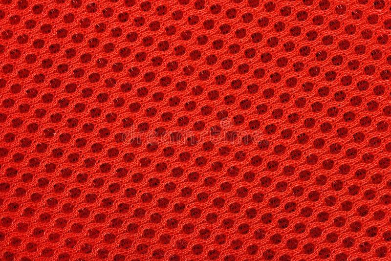 Πορτοκαλιά μη υφανθείσα σύσταση υποβάθρου υφάσματος στοκ εικόνα