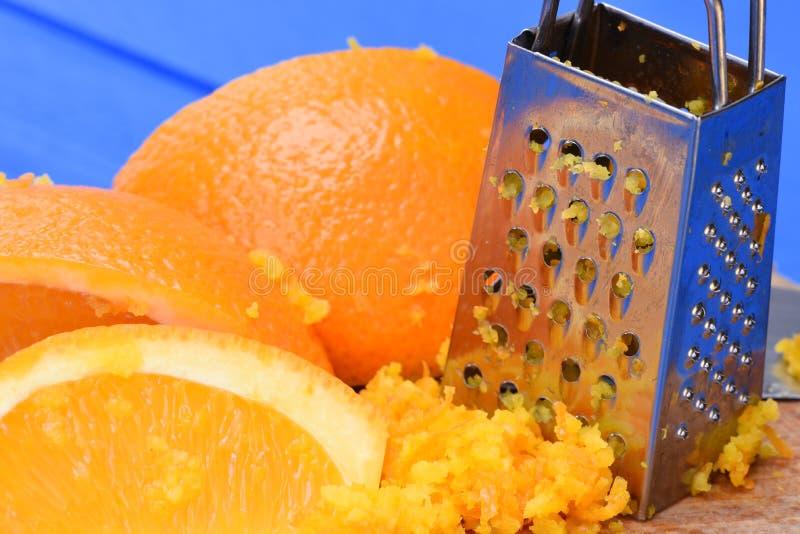 Πορτοκαλιά φρούτα και πορτοκαλιά απόλαυση με τον ξύστη στοκ φωτογραφία με δικαίωμα ελεύθερης χρήσης