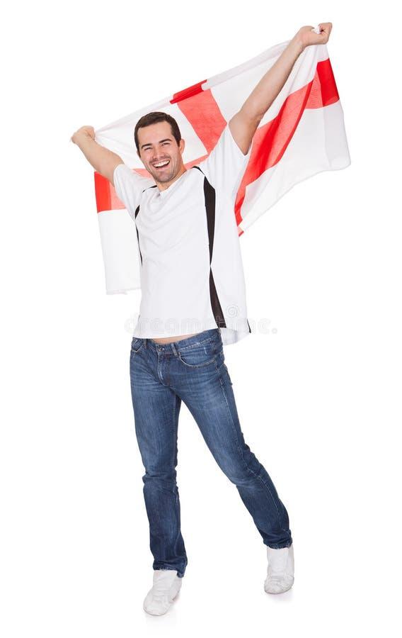 Πορτρέτο ενός ευτυχούς ατόμου που κρατά μια αγγλική σημαία στοκ εικόνα