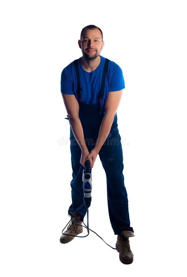 Πορτρέτο ενός νέου εργάτη που στέκεται στο άσπρο υπόβαθρο στοκ φωτογραφίες