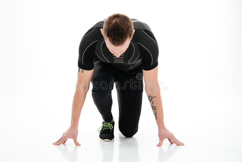 Πορτρέτο ενός συγκεντρωμένου αρσενικού sprinter που προετοιμάζεται να αρχίσει στοκ φωτογραφία με δικαίωμα ελεύθερης χρήσης