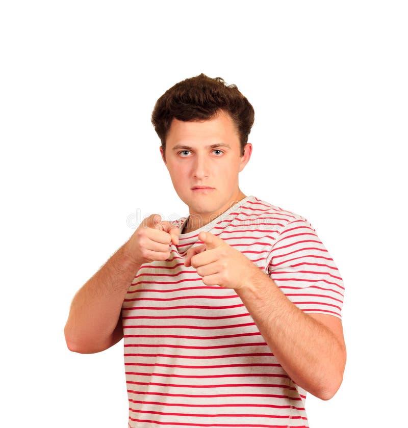 Πορτρέτο κινηματογραφήσεων σε πρώτο πλάνο του χαμογελώντας όμορφου νεαρού άνδρα που δείχνει τα δάχτυλα στη κάμερα Νέος επιχειρημα στοκ φωτογραφίες με δικαίωμα ελεύθερης χρήσης
