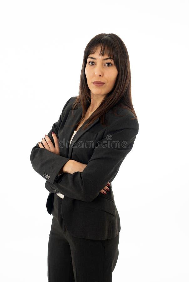 Πορτρέτο μιας σοβαρής βέβαιας επιχειρησιακής γυναίκας που φαίνεται επιτυχούς η ανασκόπηση απομόνωσε το λευκό στοκ εικόνες