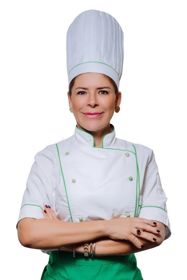 Πορτρέτο στούντιο ενός όμορφου αρχιμάγειρα γυναικών σε ομοιόμορφο Ένας χαμογελώντας μάγειρας γυναικών σε μια ΚΑΠ και ομοιόμορφος  στοκ εικόνα