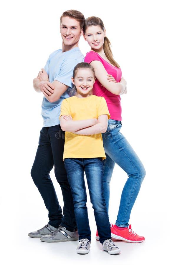 Πορτρέτο της ευτυχούς ελκυστικής οικογένειας με την κόρη στοκ φωτογραφία με δικαίωμα ελεύθερης χρήσης
