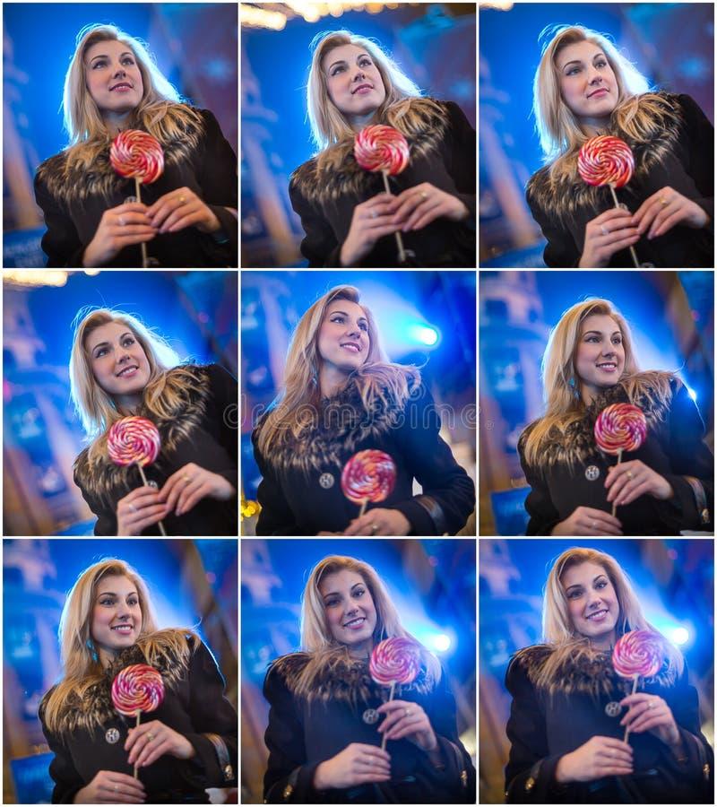 Πορτρέτο της νέας γυναίκας με τη μακροχρόνια δίκαιη τοποθέτηση τρίχας υπαίθρια το κρύο χειμερινό βράδυ Όμορφη ξανθή εκμετάλλευση  στοκ φωτογραφία με δικαίωμα ελεύθερης χρήσης