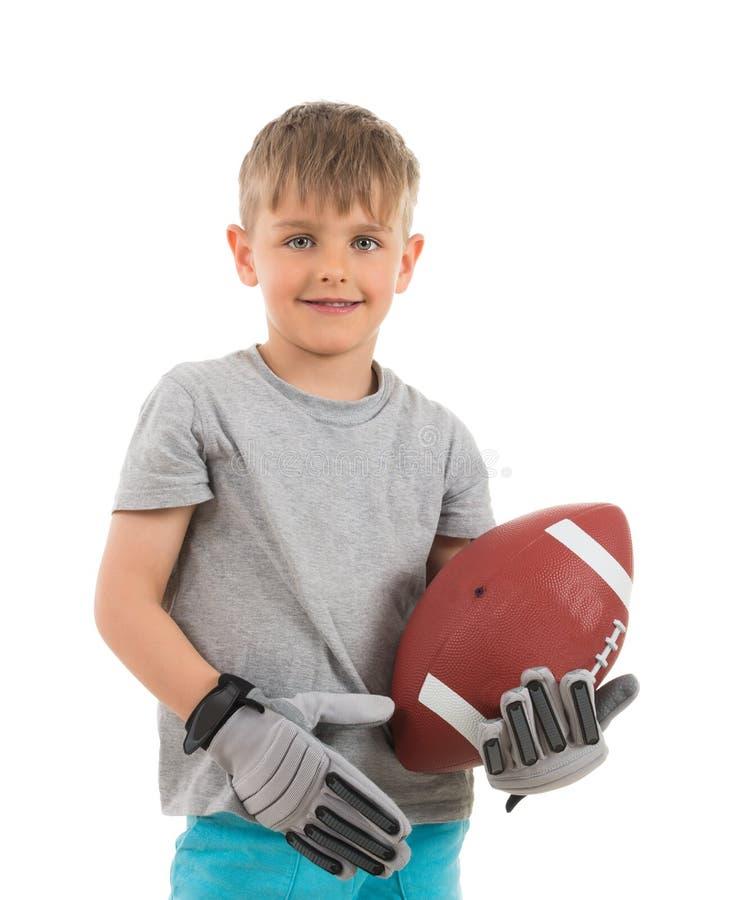 Πορτρέτο του αμερικανικού ποδοσφαίρου εκμετάλλευσης αγοριών στοκ φωτογραφίες με δικαίωμα ελεύθερης χρήσης