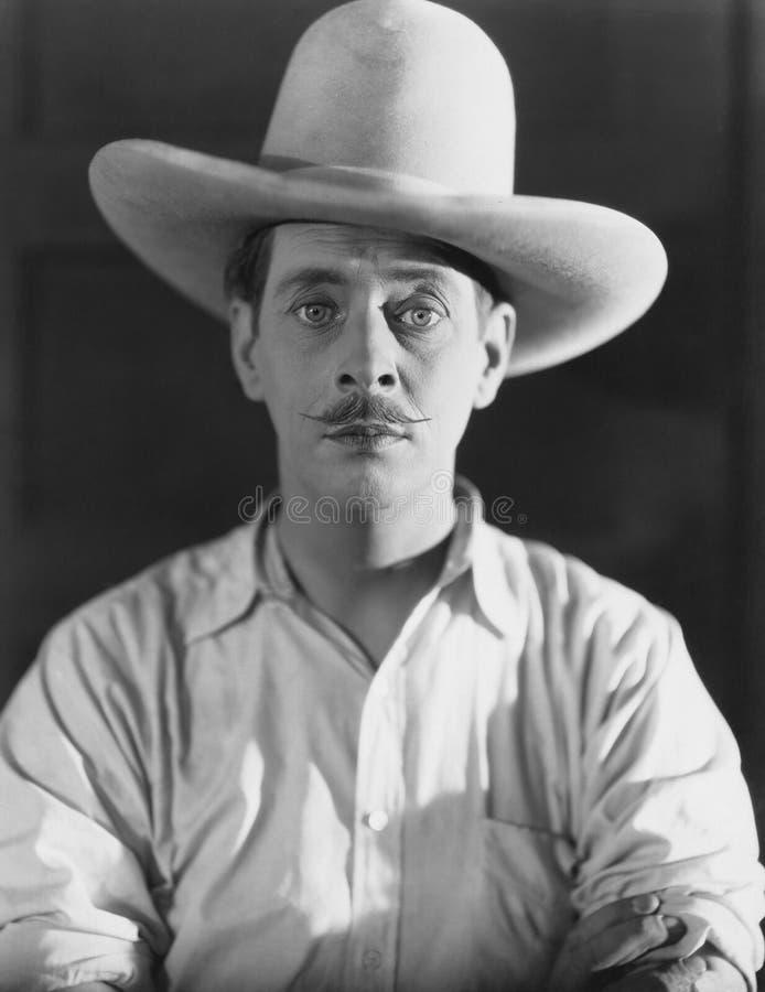 Πορτρέτο του ατόμου που φορά το καπέλο κάουμποϋ στοκ εικόνες με δικαίωμα ελεύθερης χρήσης