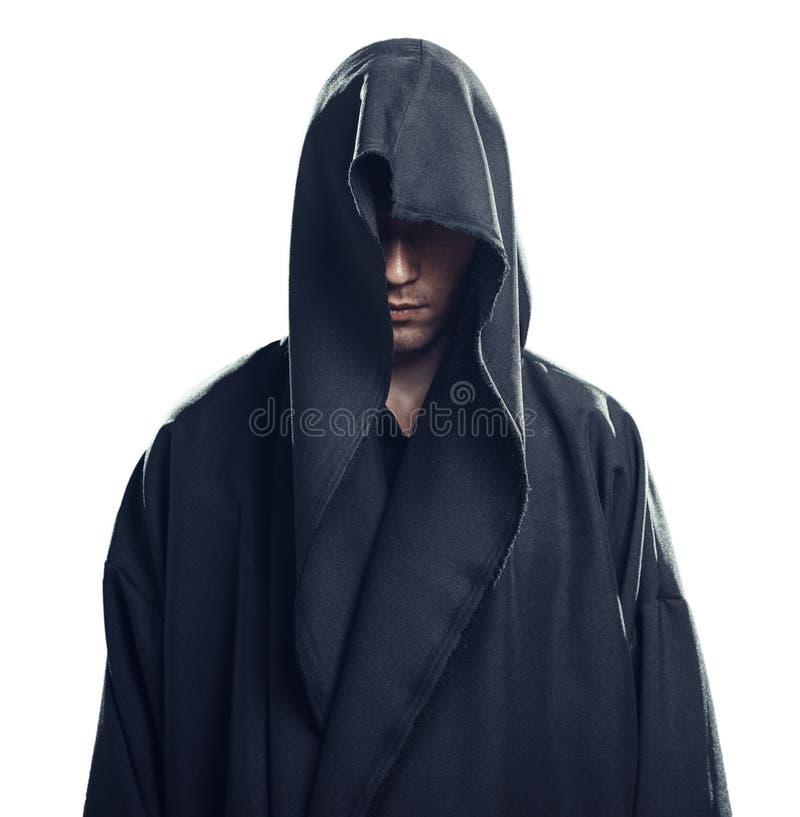 Πορτρέτο του ατόμου σε μια μαύρη τήβεννο στοκ φωτογραφία με δικαίωμα ελεύθερης χρήσης