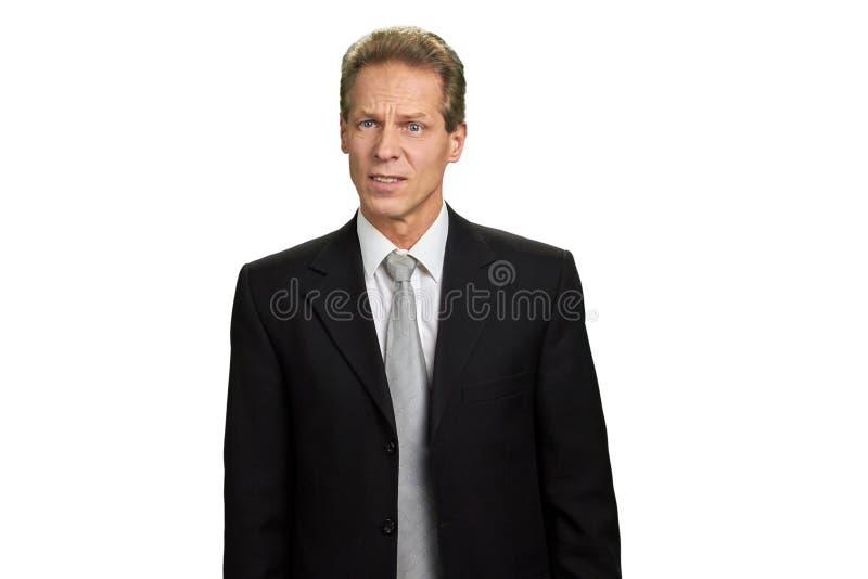 Πορτρέτο του επιχειρηματία με το συνοφρύωμα brows στοκ εικόνα