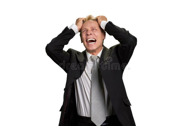 Πορτρέτο του επιχειρηματία στην πλήρη απογοήτευση στοκ εικόνες