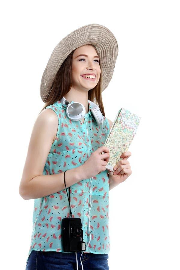 Πορτρέτο του ευτυχούς χάρτη εκμετάλλευσης γυναικών τουριστών στις διακοπές στο λευκό στοκ φωτογραφίες