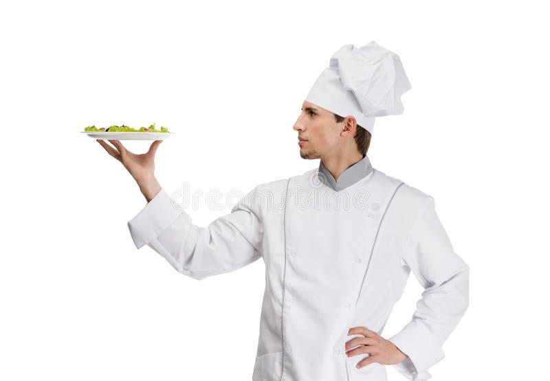 Πορτρέτο του μάγειρα αρχιμαγείρων με το πιάτο σαλάτας στοκ εικόνα