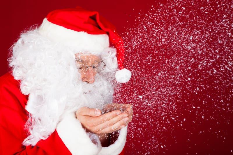 Πορτρέτο του φυσώντας χιονιού santa στοκ εικόνες