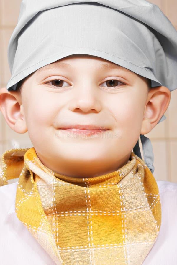 Πορτρέτο του χαμόγελου λίγου μάγειρα στοκ εικόνες με δικαίωμα ελεύθερης χρήσης