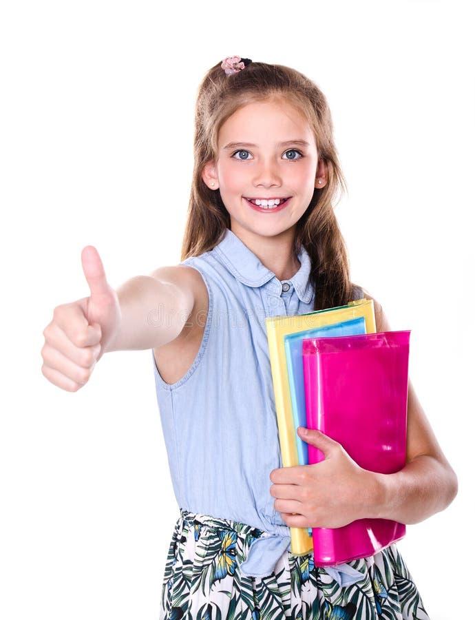 Πορτρέτο του χαριτωμένου χαμόγελου ευτυχές λίγος έφηβος παιδιών σχολικών κοριτσιών με το δάχτυλο επάνω και τα βιβλία στοκ εικόνα