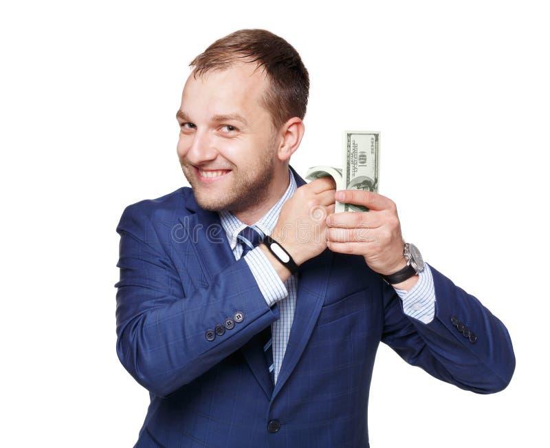 Πορτρέτο του όμορφου επιχειρηματία που παρουσιάζει δολάρια χρημάτων που απομονώνεται στοκ εικόνα με δικαίωμα ελεύθερης χρήσης