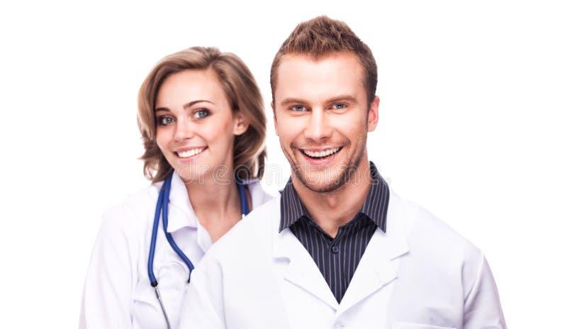 Πορτρέτο χαμογελώντας γιατροί που απομονώνονται στοκ εικόνες