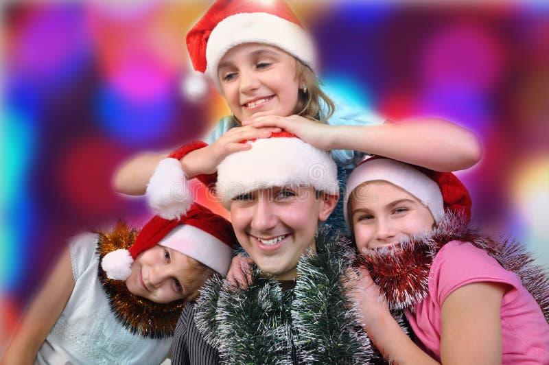 Πορτρέτο Χριστουγέννων των ευτυχών παιδιών στοκ εικόνες