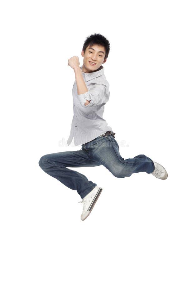 Πορτρέτο mid-air νεαρών άνδρων στοκ εικόνα με δικαίωμα ελεύθερης χρήσης