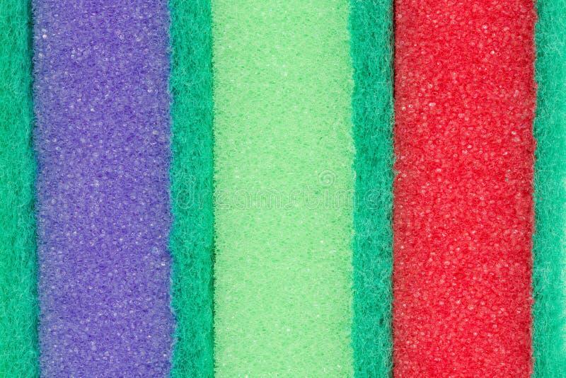 Πορφυρό, πράσινο και κόκκινο μαξιλάρι καθαρισμού στοκ εικόνες