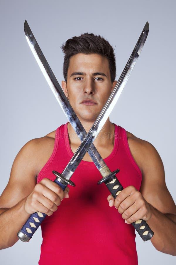 Πολεμιστής με τα ξίφη ninja στοκ φωτογραφία
