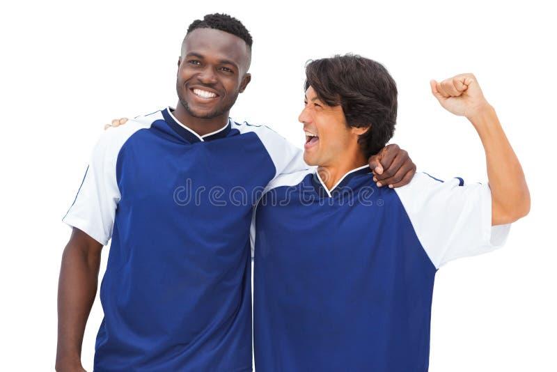 Ποδοσφαιριστές στον μπλε εορτασμό στοκ εικόνες