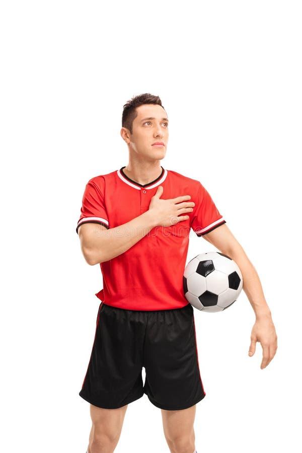 Ποδοσφαιριστής που ακούει έναν ύμνο στοκ εικόνες με δικαίωμα ελεύθερης χρήσης