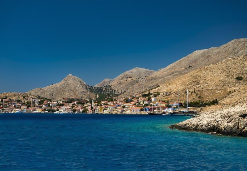Πολύχρωμα κτήρια του νησιού Halki (Chalki) στοκ εικόνα
