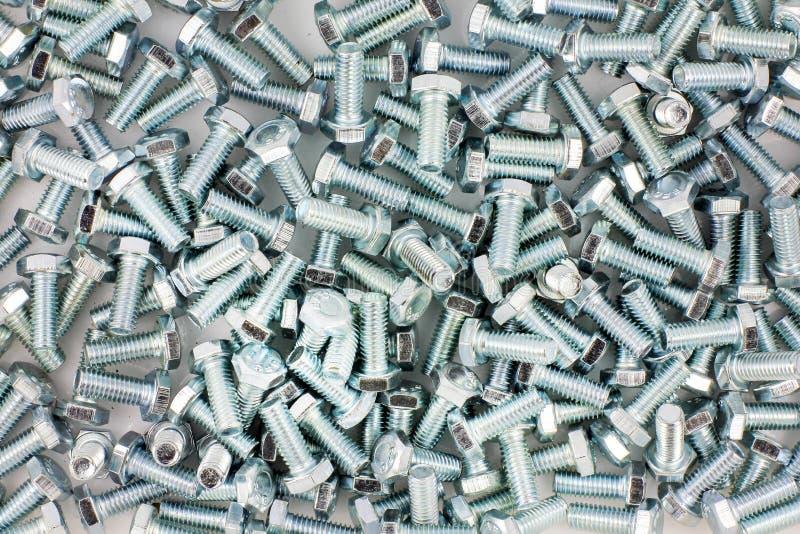 Πολύ υπόβαθρο σύστασης μπουλονιών μετάλλων στοκ φωτογραφία