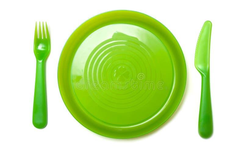 πράσινα εμπορεύματα κουζινών μωρών πλαστικά στο άσπρο υπόβαθρο στοκ φωτογραφία με δικαίωμα ελεύθερης χρήσης