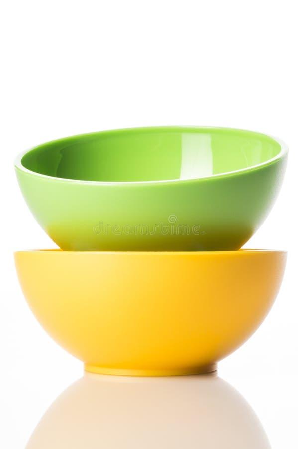 Πράσινα και κίτρινα κύπελλα στοκ φωτογραφία