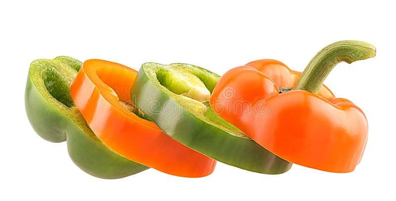 Πράσινα και πορτοκαλιά πιπέρια κουδουνιών φετών στοκ φωτογραφία